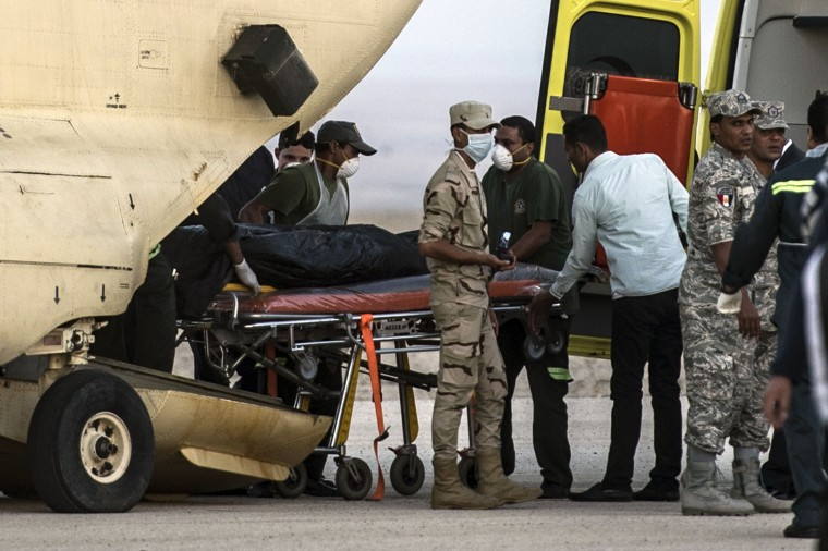 Image: Egyptian paramedics load bodies of plane crash victims