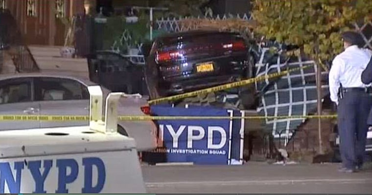 Police respond at the scene where a car careened on to the sidewalk in the Bronx, killing three people.