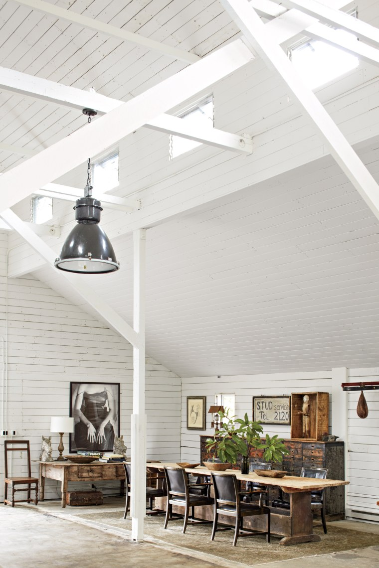 The dining room of the barn consisted of a seventeenth-century Swedish farm table surrounded by Swedish armchairs, circa 1930. The eighteenth-century Spanish desk, nineteenth-century cabinet, and antique American speed bag rounded out the room.
