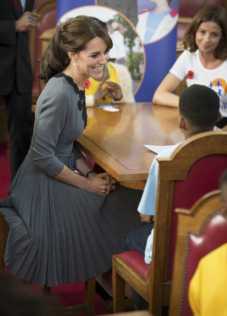 Image: Britain's Kate, the Duchess of Cambridge, chats to children during a visit to Chance UK's early intervention programme in Islington, London