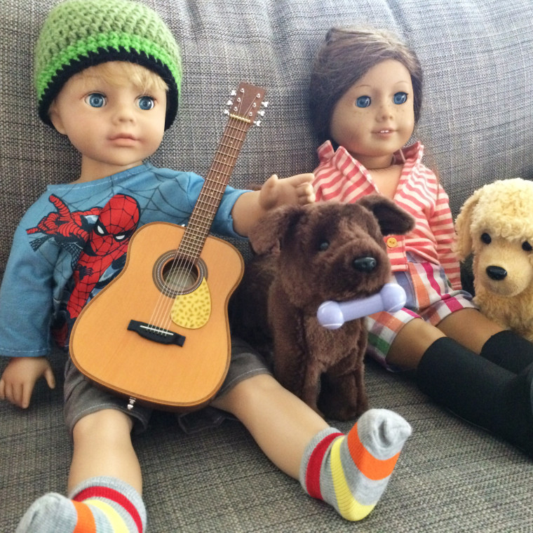 """Miles' new """"American Boy"""" doll is pictured with his sister Bronwynn's American Girl doll."""