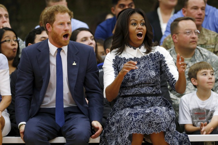 Image: Britain's Prince Harry and first lady Michelle Obama