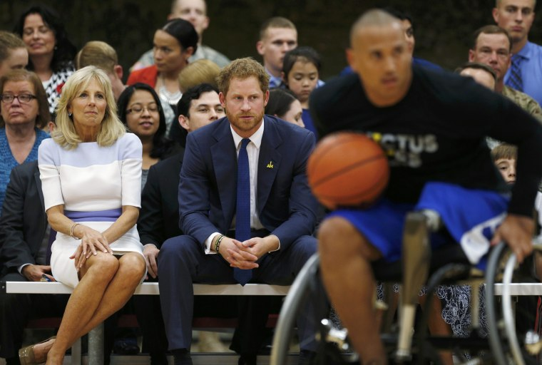 Image: Dr. Biden and Britain's Prince Harry watch a basketball game during a tour of the USO Warrior and Family Center at Fort Belvoir, Virginia