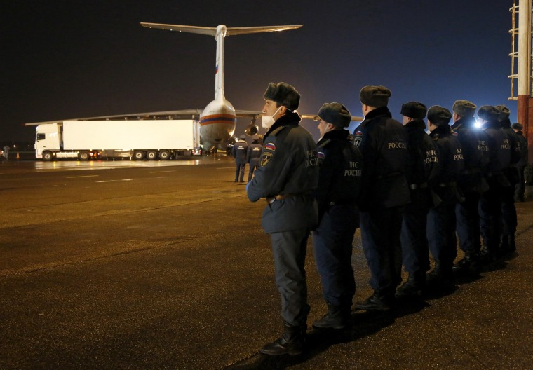 Image: Russian emergency ministry officers wait at Pulkovo airport