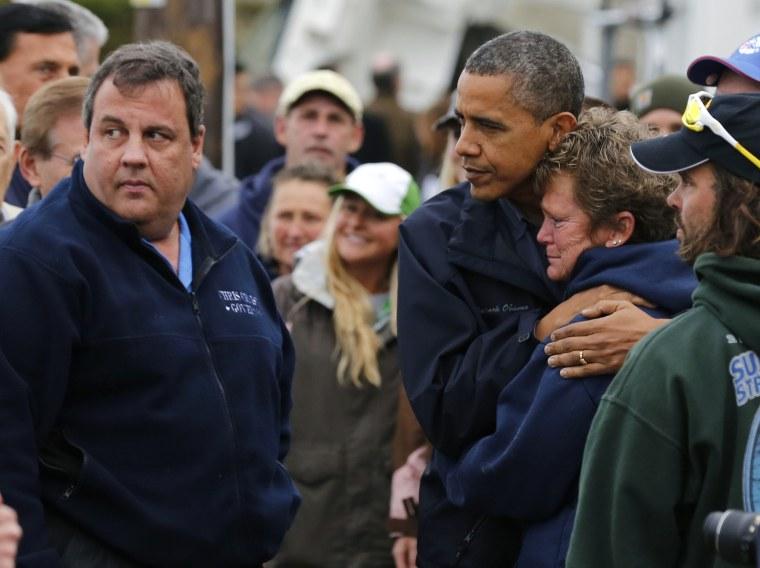 Image: U.S. President Barack Obama hugs marina owner after it was destroyed by Hurricane Sandy in New Jersey