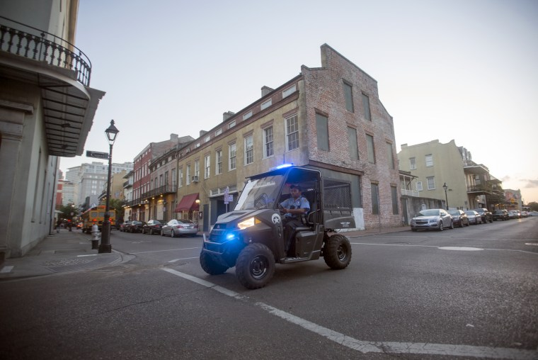 An off-duty NOPD officer working on the French Quarter Task Force patrols the French Quarter in New Orleans on May 6, 2015.