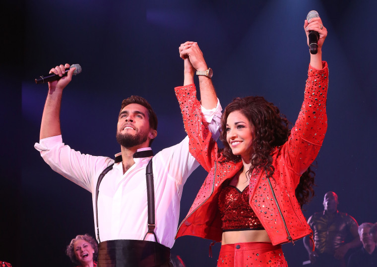 Josh Segarra as 'Emilio Estefan' and Ana Villafane as 'Gloria Estefan' perform at the first performance of 'On Your Feet! The Story Of Emilio And Gloria Estafan' on Broadway at The Marquis Theater on October 5, 2015 in New York City.