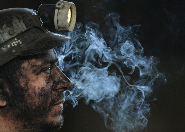 Image: A miner is seen at the end of his last shift at the coal mine in the Romanian city of Petrila