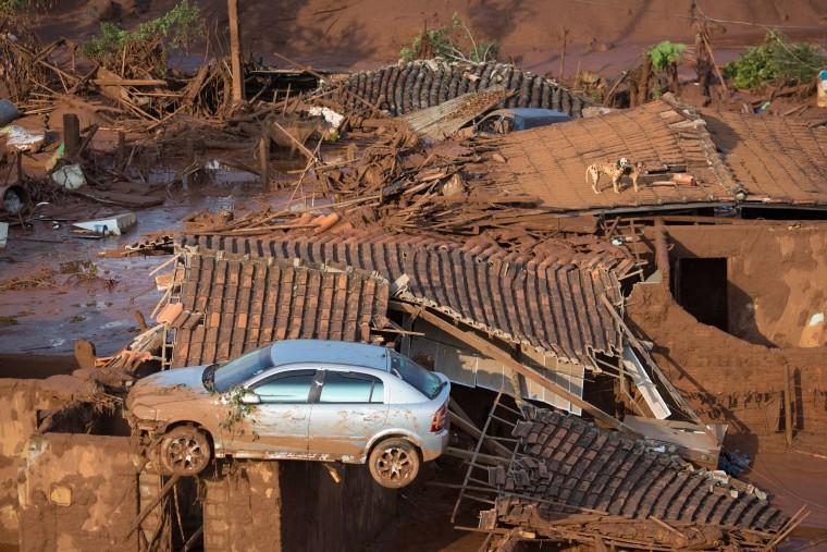 Image: A car balances on a destroyed home on Nov. 6.