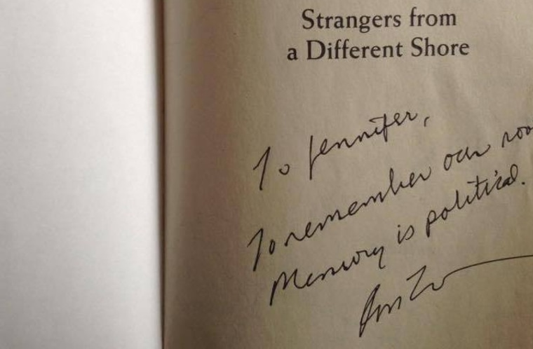 """A signed inscription of the Asian American historical text """"Strangers From a Different Shore"""" by Professor Ronald Takaki which reads """"Remember our roots. Memory is political."""""""