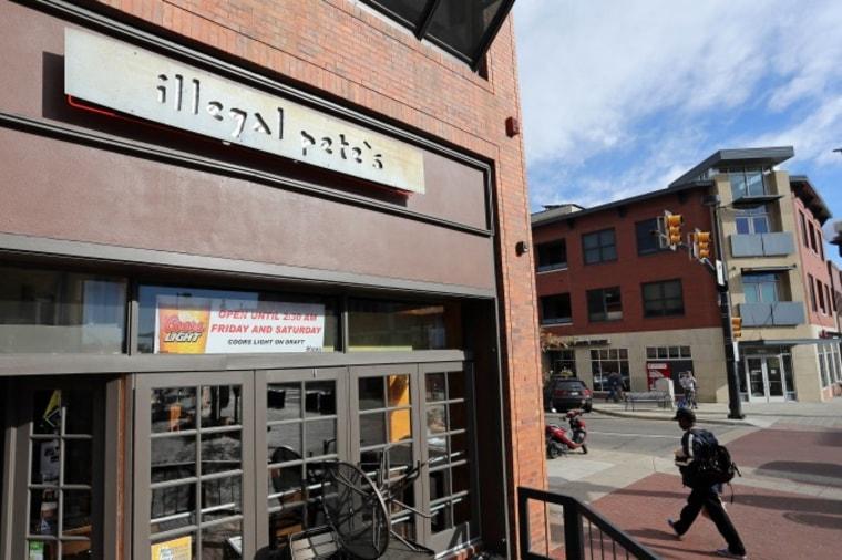 A man walks past an Illegal Pete's restaurant, in Boulder, Colo., Thursday, Oct. 23, 2014.