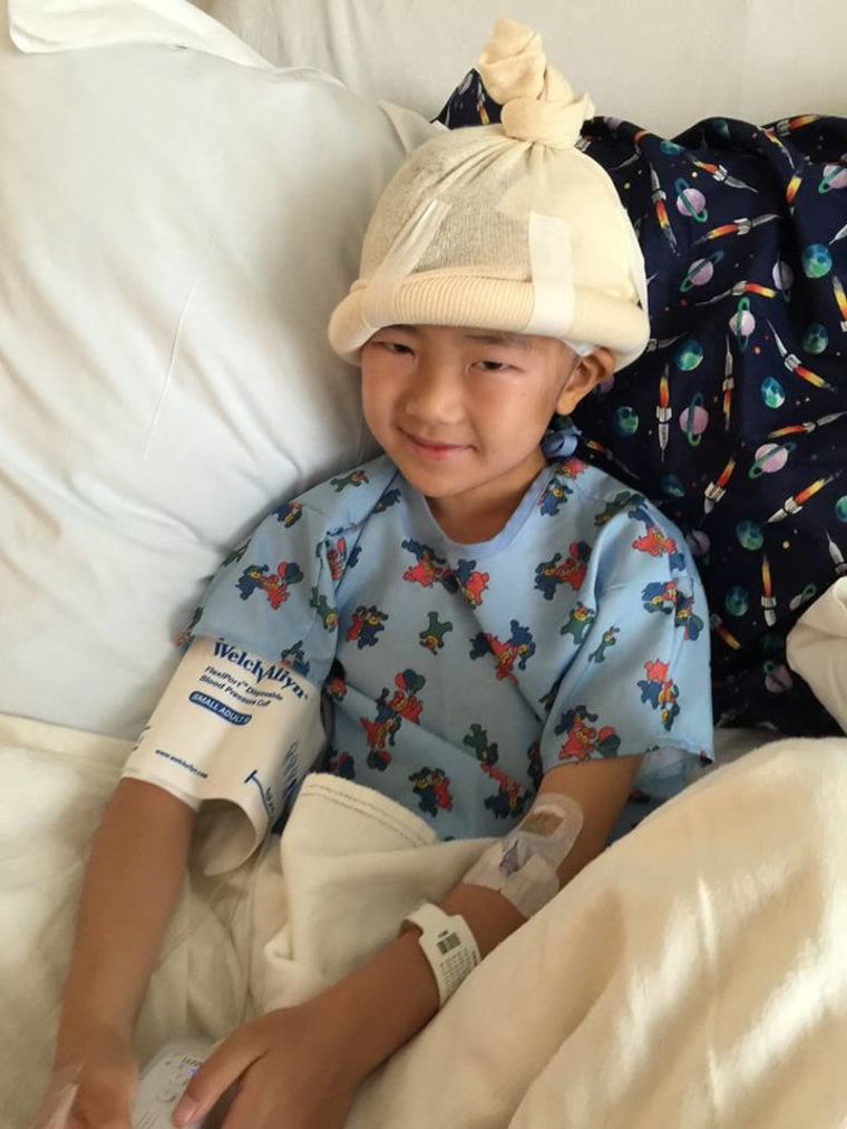 Jeremy Tsou, 7, was admitted to the ICU in May after a head injury he received while at school. Tsou says another student pushed him, but an investigation by the school concluded Tsou tripped on a pencil.