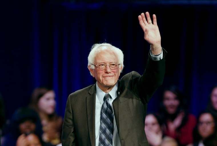 Image: Democratic presidential candidate Bernie Sanders waves to the crowd