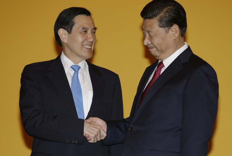 Chinese President Xi Jinping, right, and Taiwanese President Ma Ying-jeou, left, shake hands at the Shangri-la Hotel on Saturday, Nov. 7, 2015, in Singapore. The two leaders shook hands at the start of a historic meeting marking the first top level contact between the formerly bitter Cold War goes since they split amid civil war 66 years ago.