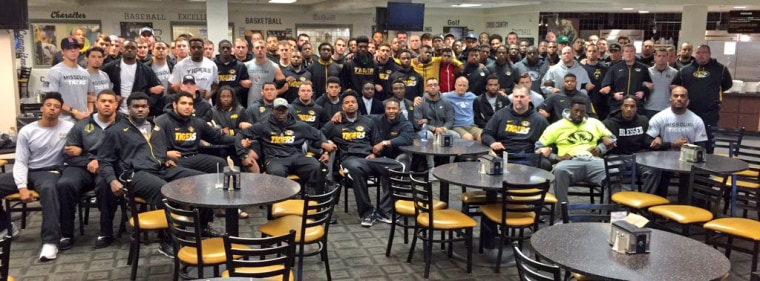 "Coach Gary Pinkel tweeted this picture of the University of Missouri football team, saying ""The Mizzou Family stands as one. We are united."""