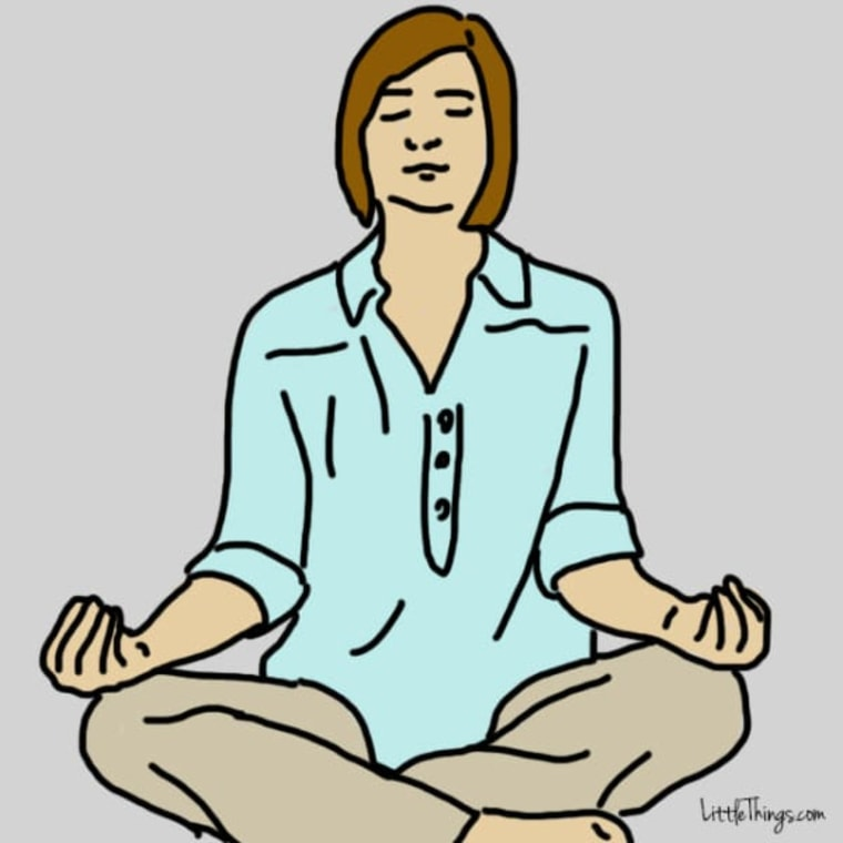 Woman practices meditation