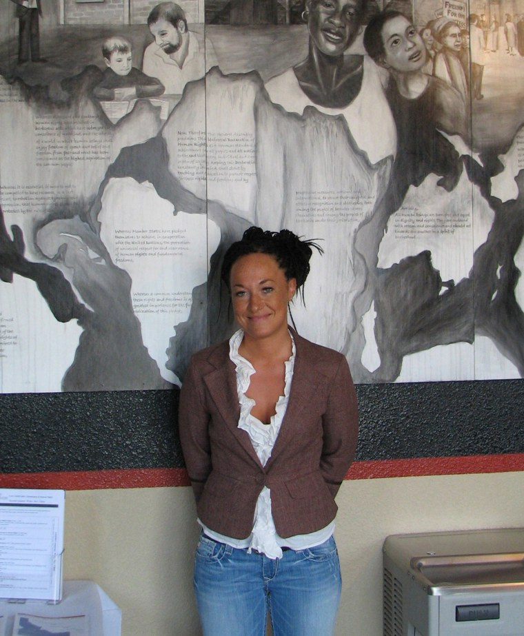 Image: Rachel Dolezal, a leader of the Human Rights Education Institute, stands in front of a mural she painted