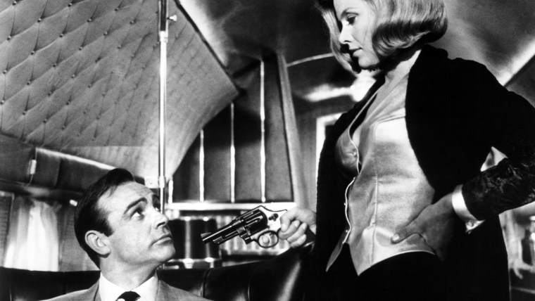 GOLDFINGER, from left: Sean Connery, Honor Blackman, 1964
