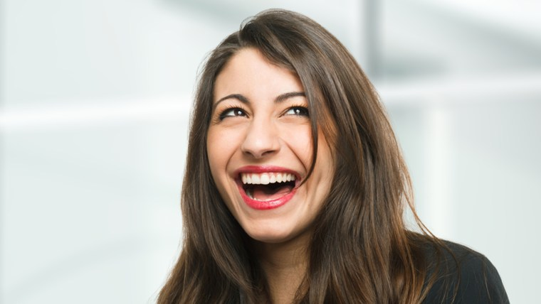 Portrait of a very happy woman laughing; Shutterstock ID 130210283; PO: laugh-stock-tongue-twister-today-tease-151106; Client: TODAY Digital