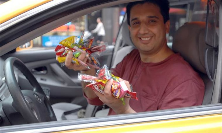 Mansoor Khalid in the 2012 version of his Candy Cab, where he brightened passengers' days with sweet surprises.