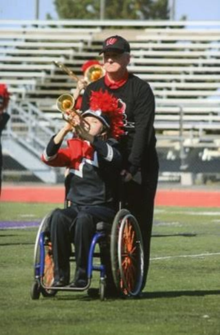 dad pushes daughter in wheelchair marching band