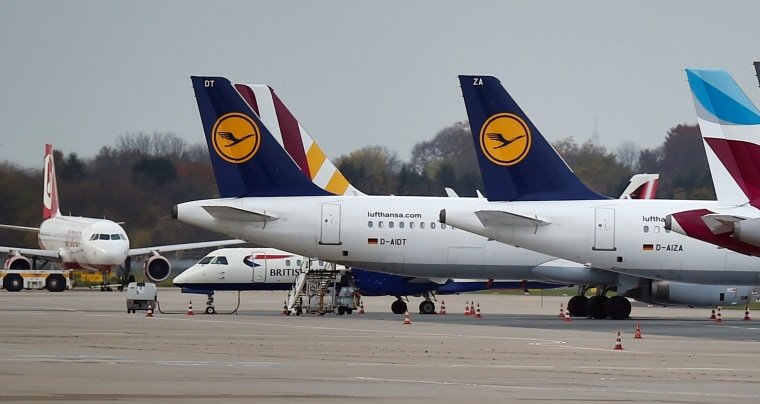 Image: Lufthansa planes park at the airport in Duesseldorf