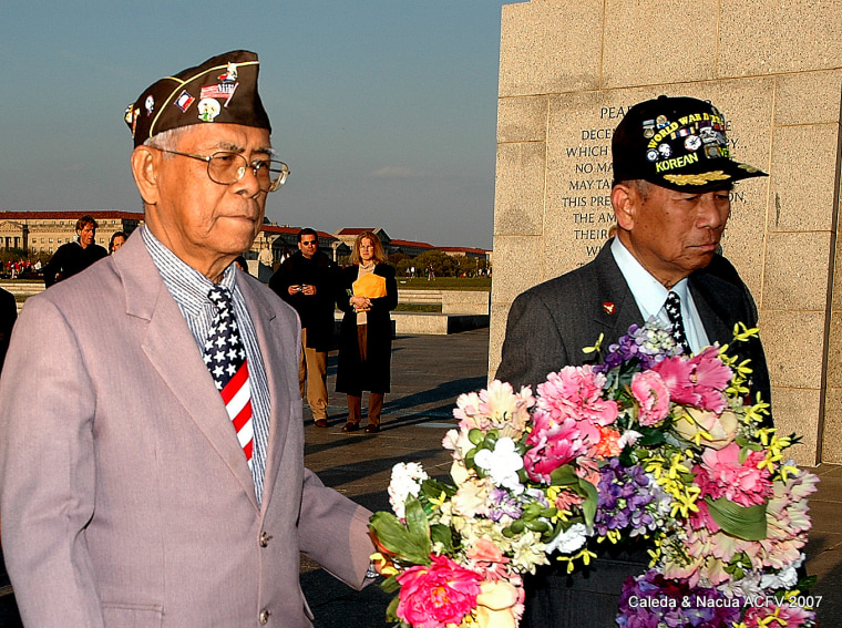 Artemio Caleda of Hawaii (left) and Regino Nacua of California march the wreath of flowers to the Bataan marker at the National World War II Memorial during the Day of Valor anniversary April 9, 2007. Caleda's service has been recognized by the VA to receive citizenship and some medical benefits. But because he is listed by his military alias in the U.S. Army official records, he has been denied a $15,000 lump sum benefit granted to Filipino-American veterans of WWII.