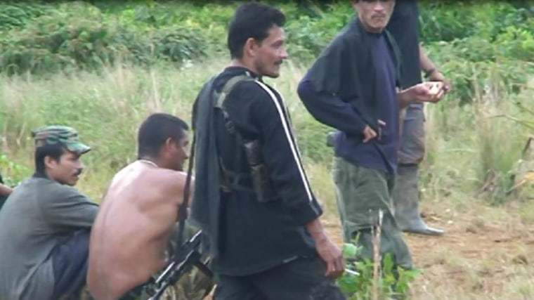 Image: Baltran in the jungle with an AK-47 rifle