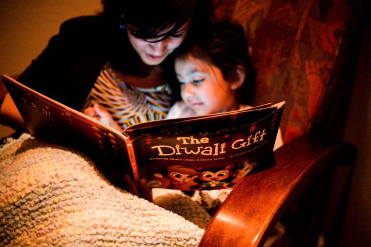 "3 Curious Monkeys co-founder Shweta Chopra reading ""The Diwali Gift"" with her daughter."