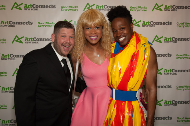 Exhibiting artists Greg Frederick and Andre St.Clair stand with curator Souleo for Art Connects New York