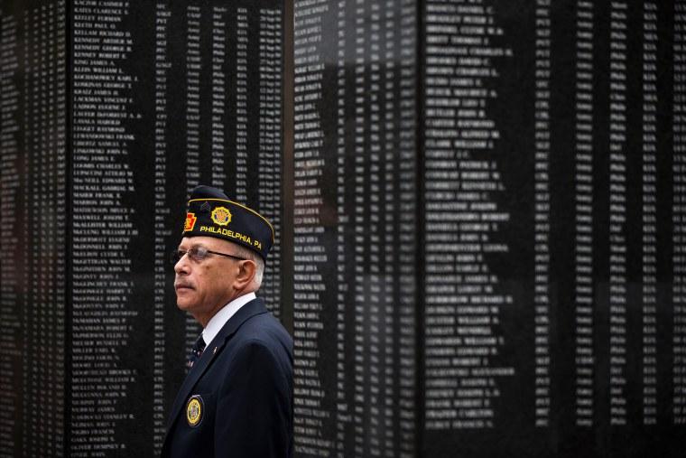 Image: Vietnam veteran Jose Angle Rivera pays his respects at the Korean War Memorial