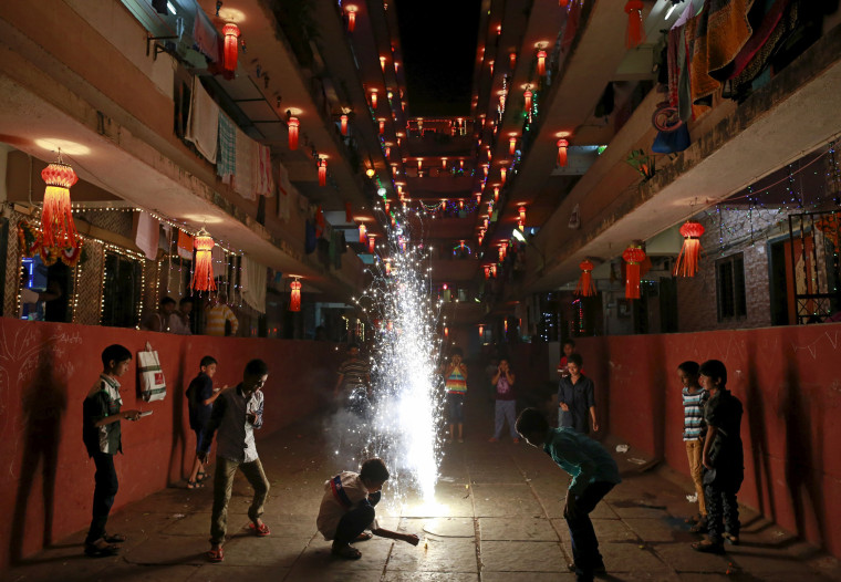Image: Children play with fire crackers while celebrating the Hindu festival of Diwali, the annual festival of lights in Mumbai
