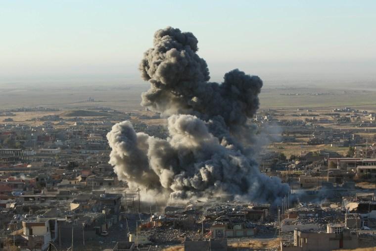Image: Smoke rises from Sinjar, Ira