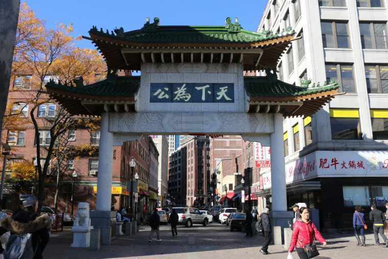 A view of Boston's Chinatown Gate from within Chinatown, looking out towards the I-93 ramps.