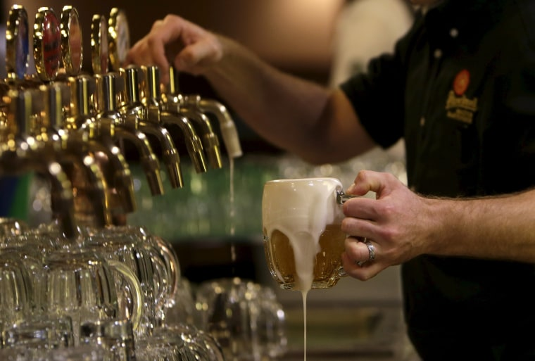 Image: A bartender drafts a glass of beer at Plzensky Prazdroj (Pilsner Urquell) brewery in Plzen