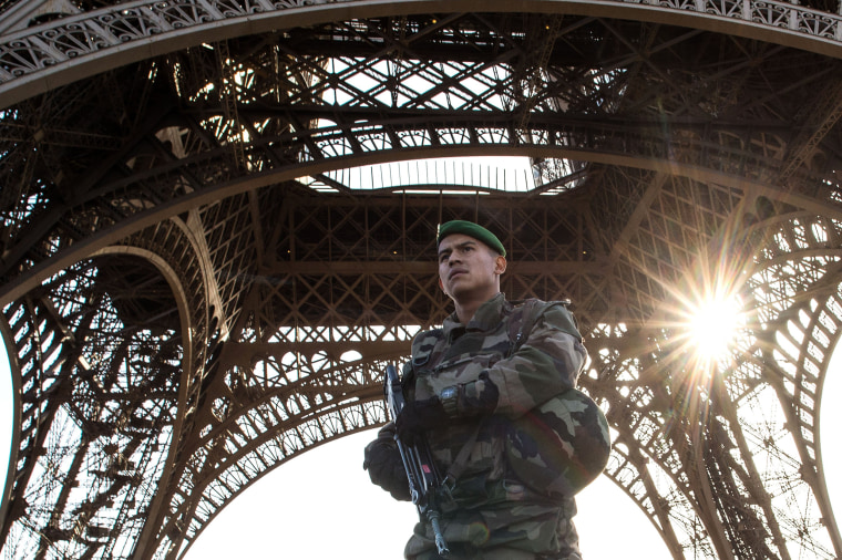 Image: A French soldier stands guard at the Eiffel Tower
