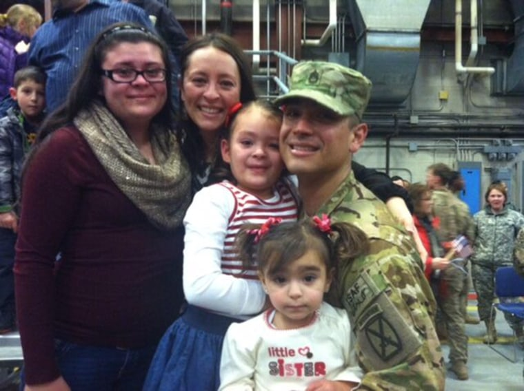 Kimberly Perez with her husband, SFC Aaron Perez, and three of their five daughters.