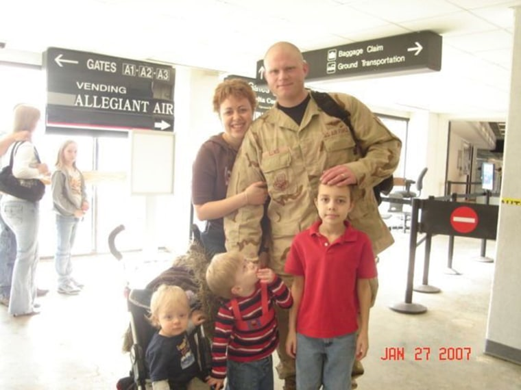 Thera Lewis with her husband, Joshua Lewis, and their children Christopher, Blaine and Noah.