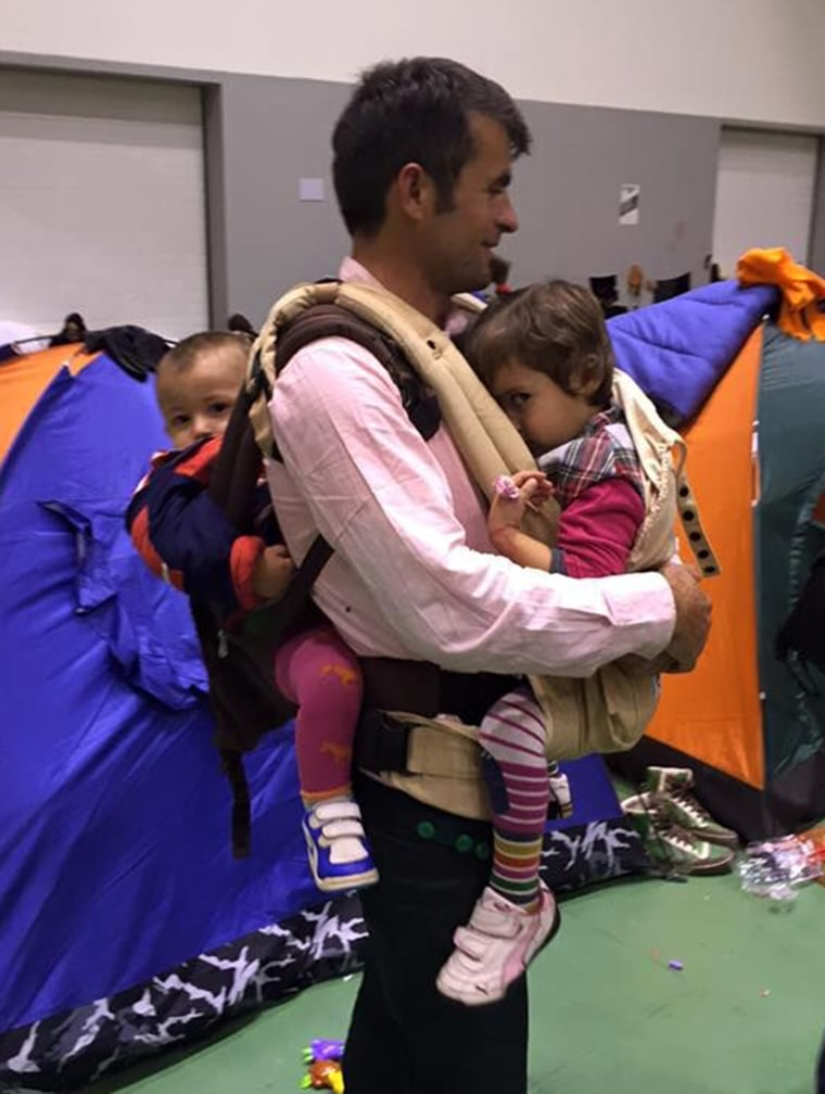 An Afghan father in a refugee camp outside of Athens asked Carry the Future reps to teach him how to wear both of his small children.