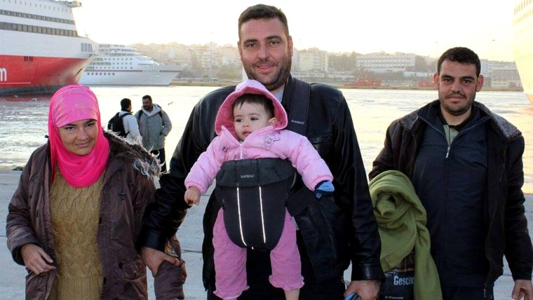 A Syrian family arriving from the Greek islands. Their baby doesn't have socks on. With the winter coming and the refugees only at the beginning of their journeys, frostbite on hands and feet is a big concern for them. Most of their socks are constantly wet which exacerbates the problem.