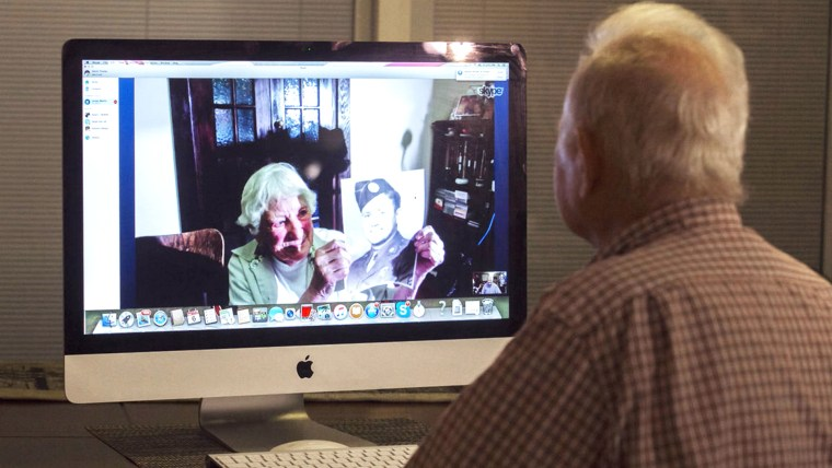 Norwood Thomas, at right, chats on Skype with Joyce Morris, a girl he dated while he was deployed outside London during WWII.