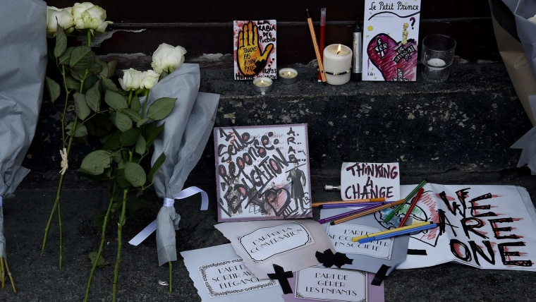 Tributes to victims of the attacks lie near the entrance to the Carillon restaurant in Paris on November 14, 2015 following a series of coordinated attacks in and around Paris late Friday which left more than 120 people dead.