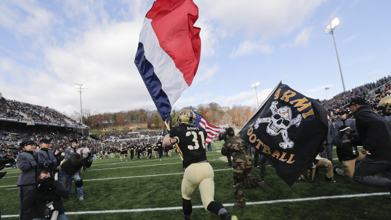 Army players carry the flag of France onto the field before an NCAA college football game against Tulane on Saturday, Nov. 14, 2015, in West Point, N.Y.