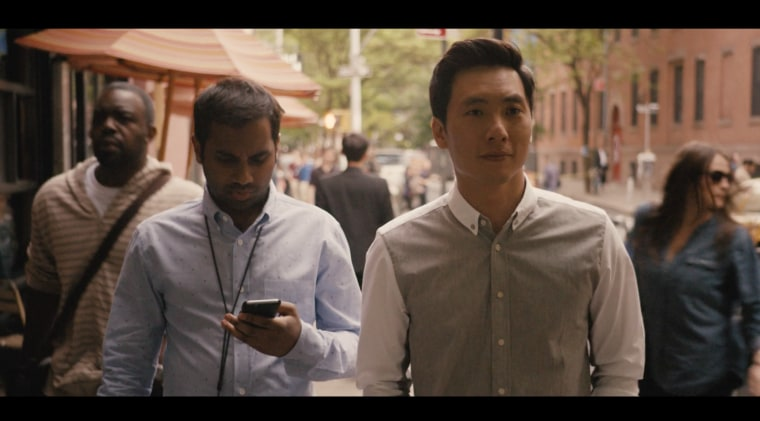 "Dev (played by Aziz Ansari, left) and Brian (played by Kelvin Yu, right) discuss their parents in a scene from Netflix's ""Master of None."""