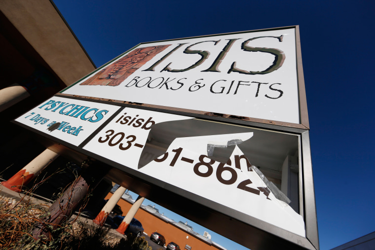 Image: A sign outside Isis Books and Gifts store is broken