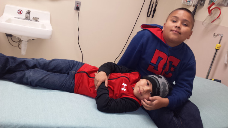 Brothers Juan, 12,  and Javier Salas, 7, of Phoenix both carry rare cancer-causing mutations.