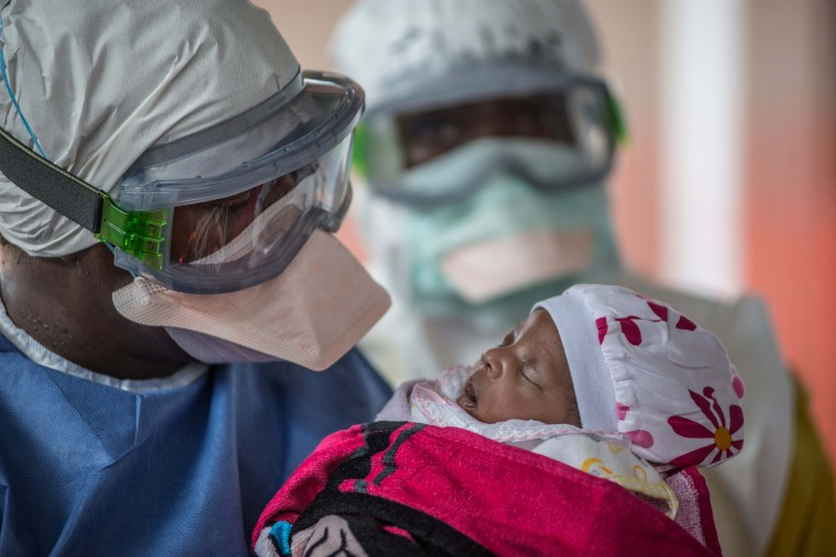 Nubia is visited by her uncle Adama at the Doctors Without Borders Ebola clinic in Conakry, Guinea.