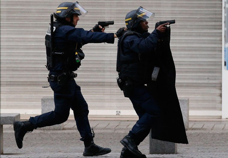 Image: Police forces operate in Saint-Denis