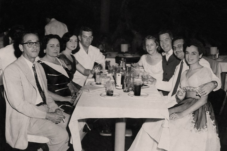 Raida Pita sits at the far right with a group of friends in her native Cuba.