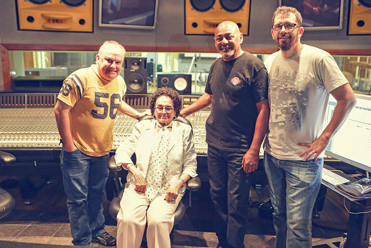 Raida Pita posses with arranger Randy Barlow, one of the invited musicians and producer Sebastian Krys at The Hit Factory/Criteria Studios.